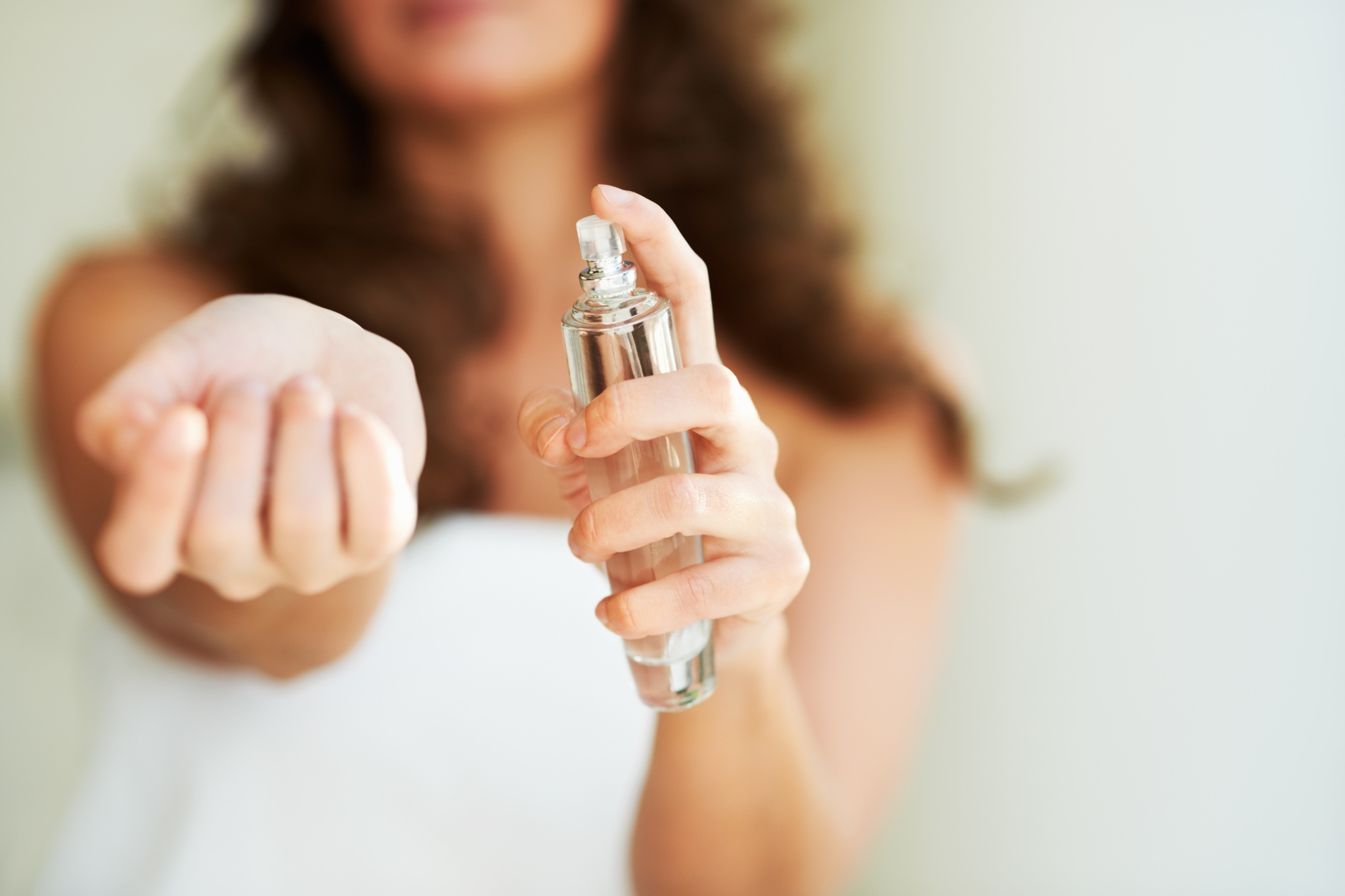 Person using fragrance perfume